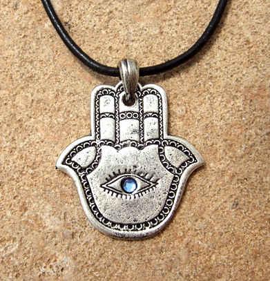 http://www.evileyebeads.org/wp-content/uploads/2009/11/hamsa-evil-eye-beads.jpg
